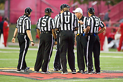 24 September 2011: Officiating crew led by referee Wally Righton meet at mid-field during an NCAA football game between the South Dakota State Jackrabbits (SDSU) and the Illinois State Redbirds (ISU) at Hancock Stadium in Normal Illinois.