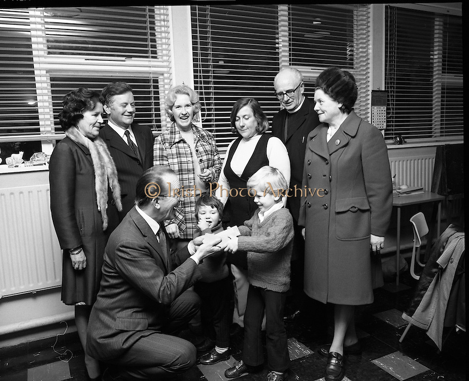 Jack Cruise at St Joseph's School for the Deaf..1972..19.11.1972..11.19.1972..19th November 1972..A charity walk, organised by the school committee, to aid the fund raising for a new swimming pool in St Josephs School for the Deaf took place yesterday..Jack Cruise,the comedian,presented tickets for his Christmas pantomime,at The Olympia, to all those who took part in the walk...Picture shows Jack Cruise Presenting the tickets for the pantomime to Brendan Coyne (age5) the youngest pupil at the school in Cabra. Looking on are Mrs Jack Cruise and members of the organising Committee.