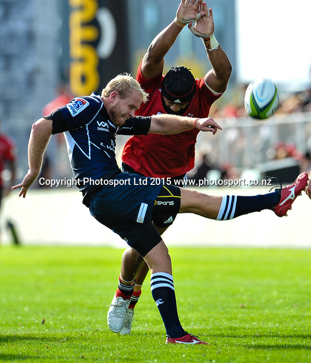 Ross Cronje of the Lions gets a kick away under pressure from Jordan Taufua of the Crusaders during the Super Rugby match: Crusaders v Lions at AMI Stadium, Christchurch, New Zealand, 14 March 2015. Copyright Photo: John Davidson / www.Photosport.co.nz