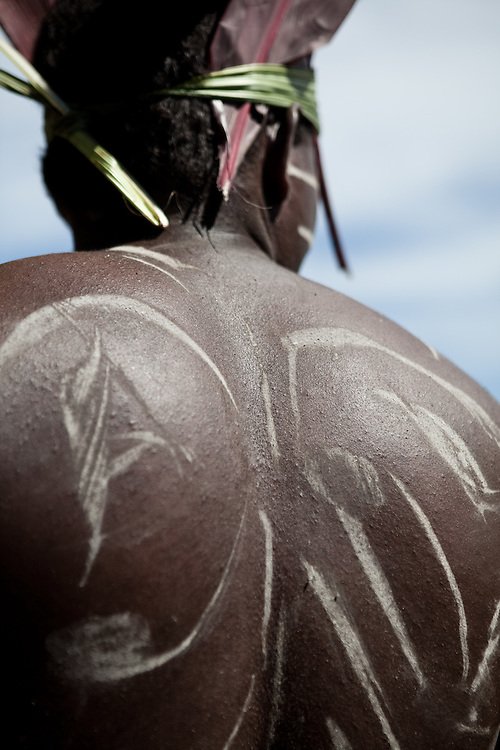 The back of a Solomon Islander with body paint