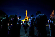YANGON, MYANMAR - SEPTEMBER 17, 2012.Commuters wait for bus as Sule Pagoda is seen in background in Yangon, Myanmar on Sep 17, 2012..After nearly five decades where the military had tight control over people's lives, the arrival of democracy has led to debates about a new national identity for the country..(Photo by Kuni Takahashi)...