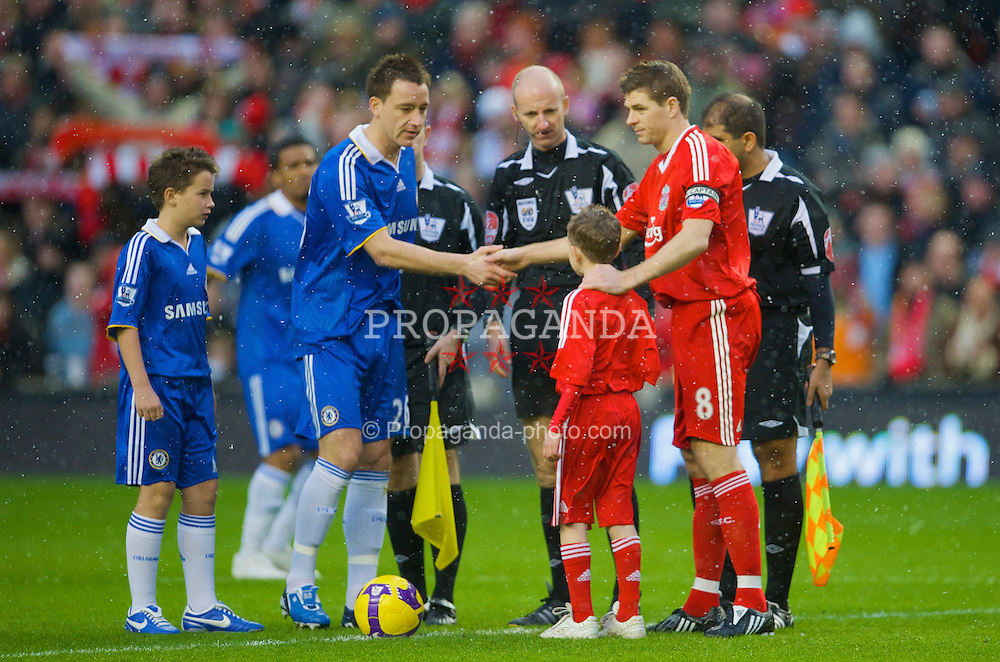 LIVERPOOL, ENGLAND - Sunday, February 1, 2009: Liverpool's captain Steven Gerrard MBE and Chelsea's captain John Terry with referee Mike Riley and mascots before the Premiership match at Anfield. (Mandatory credit: David Rawcliffe/Propaganda)