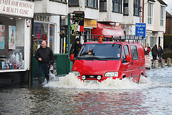 © Licensed to London News Pictures. 10/02/2014. Datchet, Berkshire, UK. A van driving through through flood water. Flooding in Datchet today, 10th February 2014 after the River Thames burst its banks. Photo credit : Rob Arnold/LNP