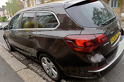 Cars in Wimbledon are covered in dust and sand after powerful dust storms in the Sahara have caused the rain to deposit dust and sand on the streets of southern England.<br /> Wednesday, 2nd April 2014. Picture by Ben Stevens / i-Images