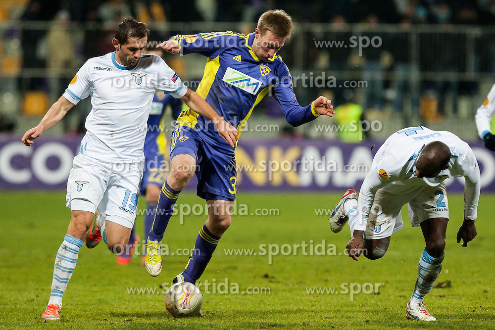 Senad Lulic #19 of S.S. Lazio and Robert Beric #32 of Maribor and Michael Ciani #2 of S.S. Lazio during football match between NK Maribor and S. S. Lazio Roma  (ITA) in 6th Round of Group Stage of UEFA Europa league 2013, on December 6, 2012 in Stadium Ljudski vrt, Maribor, Slovenia. (Photo By Gregor Krajncic / Sportida)