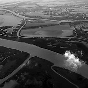 "An aerial view of the complex and fragile coastal boundaries of Lousiana. The Gulf Coast is made up of a delicate mix of bayous, marshes, rivers and sea, all of which are threatened from the Deepwater Horizon Oil Spill. ltqmb ""Fragile Boundaries"""