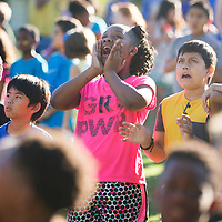 Pierce Street fourth grader Jordyn Medcall, 10, center, yells out in excitement as the Tupelo Water and Light bucket truck lowers back to the ground after students and staff took a photo while spelling out 'PSE 50th' Friday morning at the elementary school. The photo was taken to commemorate the 50th anniversary of the school.