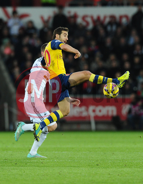 Arsenal's Mathieu Flamini battles for the ball  - Photo mandatory by-line: Joe Meredith/JMP - Mobile: 07966 386802 - 09/11/2014 - SPORT - Football - Swanswa - Liberty Stadium - Swansea City v Arsenal - Barclays Premier League