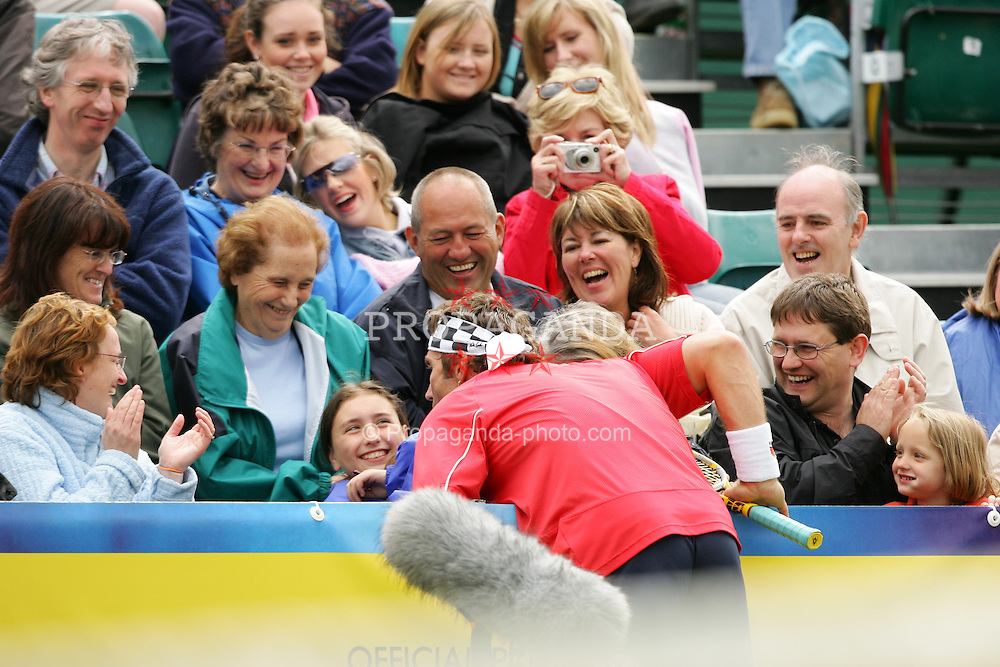 LIVERPOOL, ENGLAND - SUNDAY, JUNE 12th, 2005: Pat Cash tries to kiss a fan during an Exhibition match of the Liverbird Developments Liverpool International Tennis Tournament in Calderstones Park. (Pic by David Rawcliffe/Propaganda).