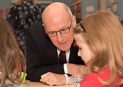 Education Secretary John Swinney was at Towerbank Primary School, Portobello, Edinburgh to give out gift packs of books and games to P2 and P3 children as part of a national campaign to improve literacy and numeracy skills.<br /> &copy; Jon Davey/ EEm