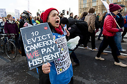 © Licensed to London News Pictures. 30/01/2016. London, UK. Protesters from Lambeth Housing Activists are joined by housing groups, trades unions and supporters to stage a protest and march against the Housing Bill starting at the Imperial War Museum and ending outside Downing Street. Demonstrators claim that The Housing Bill marks the end of social housing and council housing and that private renters and travellers will have reduced housing rights and that developers will have to build 'starter homes' for sale instead of 'affordable' homes for rent. Photo credit : Vickie Flores/LNP
