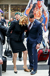 © Licensed to London News Pictures. 24/03/2017. London, UK. CLAIRE BLACKMAN (C), wife of Sergeant Alexander Blackman, stops as her shoe comes off on her way to the Royal Courts of Justice in London, where sentencing of Sgt Blackman was due to come out but delayed until next Tuesday. Also known as Marine A, Sgt Blackman's life sentence was reduced to manslughter for killing a wounded Taliban fighter in Afghanistan in 2011. Photo credit: Tolga Akmen/LNP
