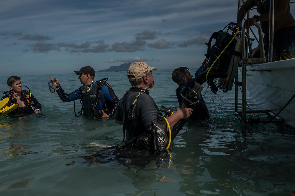 Recreation divers board a boat off the beach in Beau Vallon, Seychelles on February 21, 2018. Tourism is one of the country's main income generators.<br /> <br /> The government of Seychelles has created 81,000 square miles of Marine Protected Areas as part of a conservation debt swap deal in an effort to shield marine ecosystems from unsustainable development and climate change while safeguarding its economy.