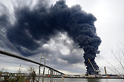 Savannah Firefighters battle a blaze in a warehouse at the Georgia Ports Authority Ocean Terminal, Saturday, Feb. 8, 2014, in Savannah, Ga. (AP Photo/Stephen B. Morton)
