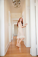 Full length of an attractive young female standing in corridor