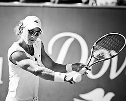 Samantha Stosur hits a back hand against Elena Vesnina during the 2011 Family Circle Cup at Daniel Island.