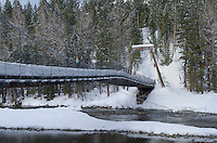 Suspension Bridge over Metho River in winter, North Cascades Washington