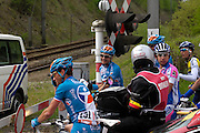 Barvaux, Luxembourg - Saturday, April 25, 2009: Riders wait for a train to pass through at a level crossing before continuing the Liege Bastogne Liege cycle race. (Image by Peter Horrell / http://peterhorrell.com)
