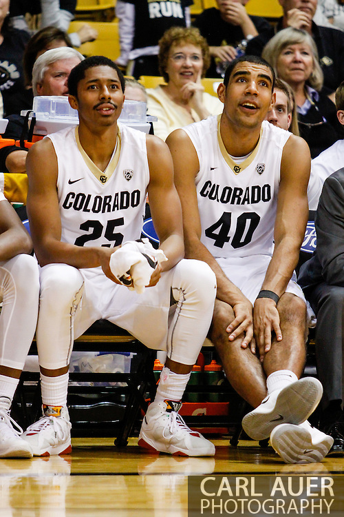 November 16th, 2013:  Colorado Buffaloes junior guard Spencer Dinwiddie (25) and sophomore forward Josh Scott (40) watch the reserves play in the second half of action in the NCAA Basketball game between the Jackson State Tigers and the University of Colorado Buffaloes at the Coors Events Center in Boulder, Colorado