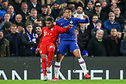 Bayern Munich midfielder Serge Gnabry (22) battles for possession with Chelsea defender Reece James (24) during the Champions League match between Chelsea and Bayern Munich at Stamford Bridge, London, England on 25 February 2020.