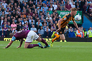Sam Clucas of Hull City is fouled by Glenn Whelan of Aston Villa during the Sky Bet Championship match at Villa Park, Birmingham<br /> Picture by Matt Wilkinson/Focus Images Ltd 07814 960751<br /> 05/08/2017