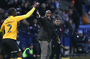 Southend United manager Sol Campbell gestures during the EFL Sky Bet League 1 match between Bolton Wanderers and Southend United at the University of  Bolton Stadium, Bolton, England on 21 December 2019.