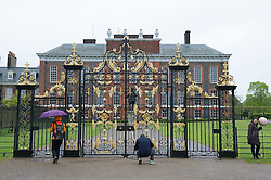 © London News Pictures. 03/04/15. London, UK. Tourists stand outside Kensington Palace as the new royal Princess spends her first morning at Kensington Palace, Central London. Photo credit: Laura Lean/LNP