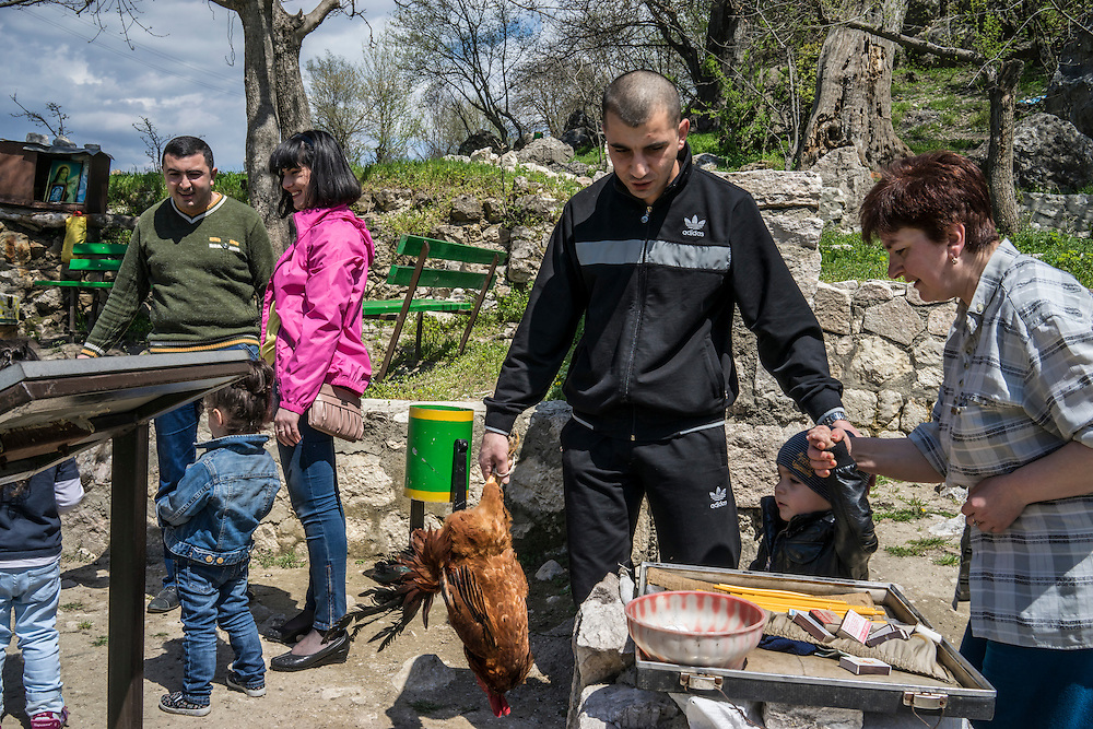 KARASHEN, NAGORNO-KARABAKH - APRIL 19: Members of the Abrahamyan family and others gather at a sacred site to sacrifice animals, which is believed to bring good fortune, on April 19, 2015 in Karashen, Nagorno-Karabakh. Since signing a ceasefire in a war with Azerbaijan in 1994, Nagorno-Karabakh, officially part of Azerbaijan, has functioned as a self-declared independent republic and de facto part of Armenia, with hostilities along the line of contact between Nagorno-Karabakh and Azerbaijan occasionally flaring up and causing casualties. (Photo by Brendan Hoffman/Getty Images) *** Local Caption ***