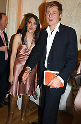 ZAC GOLDSMITH and RENU MEHTA at a party to celebrate the publication of Andrew Robert's new book 'Waterloo: Napoleon's Last Gamble' and the launch of the paperback version of Leonie Fried's book 'Catherine de Medici' held at the English-Speaking Union, Dartmouth House, 37 Charles Street, London W1 on 8th February 2005.<br />