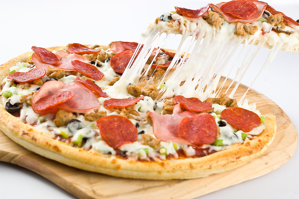 Craigos Pizza to Go supreme pizza sliced and hot with melted cheese. image of a pizza pull with stretching mozzerella cheese. Pizza board and activity of serving the pizza