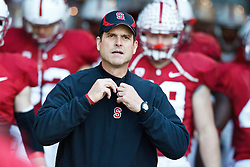 November 27, 2010; Stanford, CA, USA;  Stanford Cardinal head coach Jim Harbaugh leads his team out of the tunnel towards the field before the game against the Oregon State Beavers at Stanford Stadium.  Stanford defeated Oregon State 38-0.