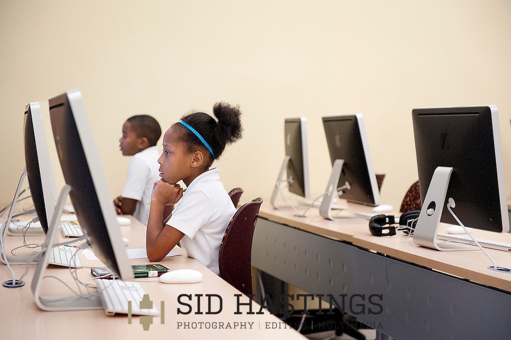 16 Sept. 2013 -- PINE LAWN, Mo. -- Fifth grade students Zanay Graves (front) and Jemerius Curry work in a computer lab at Barack Obama Elementary School in Pine Lawn, Mo. Monday, Sept. 16, 2013. The school is part of the Normandy School District in suburban St. Louis, which currently lacks state accreditation and has seen a substantial number of students transfer to other districts for school year 2013-14. Photo © copyright 2013 Sid Hastings.