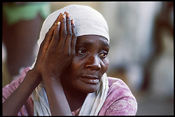 CAP HAITIEN, HAITI - A homeless woman prays for relief while passing her days in a shelter. (PHOTO © JOCK FISTICK)....