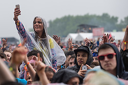 © Licensed to London News Pictures . 07/06/2014 . Heaton Park , Manchester , UK . A woman takes a selfie . The audience in front of the main stage . The Parklife music festival in Heaton Park Manchester following heavy overnight rain . Photo credit : Joel Goodman/LNP