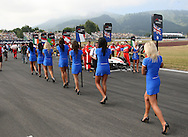 Grid girls make their way from the track prior to the start of the A1 GP Sprint Race, Taupo, New Zealand, Sunday 25 January 2009. Photo: Andrew Cornaga/PHOTOSPORT