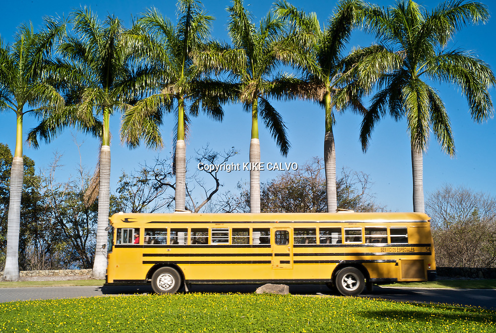 Peninsula Papagayo on Costa Rica's north Pacific Coast.Pictured: Yellow bus and palm trees at the entrance of the Four Seasons Hotel. B1276