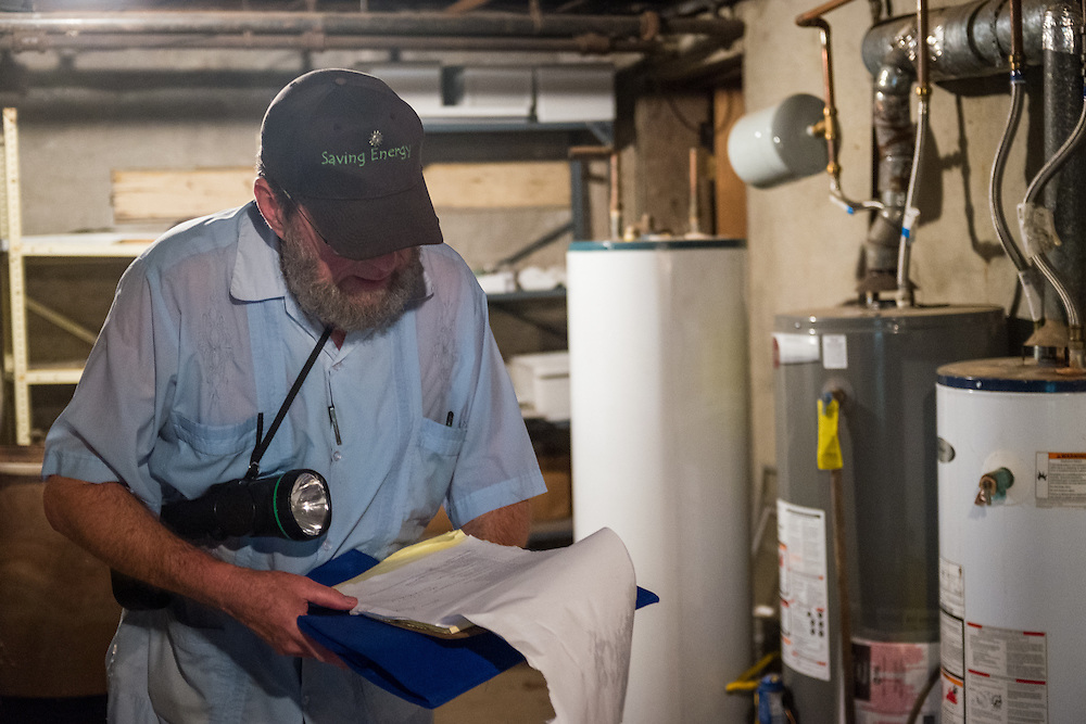 Tom Calhoun checks paperwork and forms during an energy inspection at 47 West Washtington Street on Tuesday, June 23, 2015.  Photo by Ohio University  /  Rob Hardin