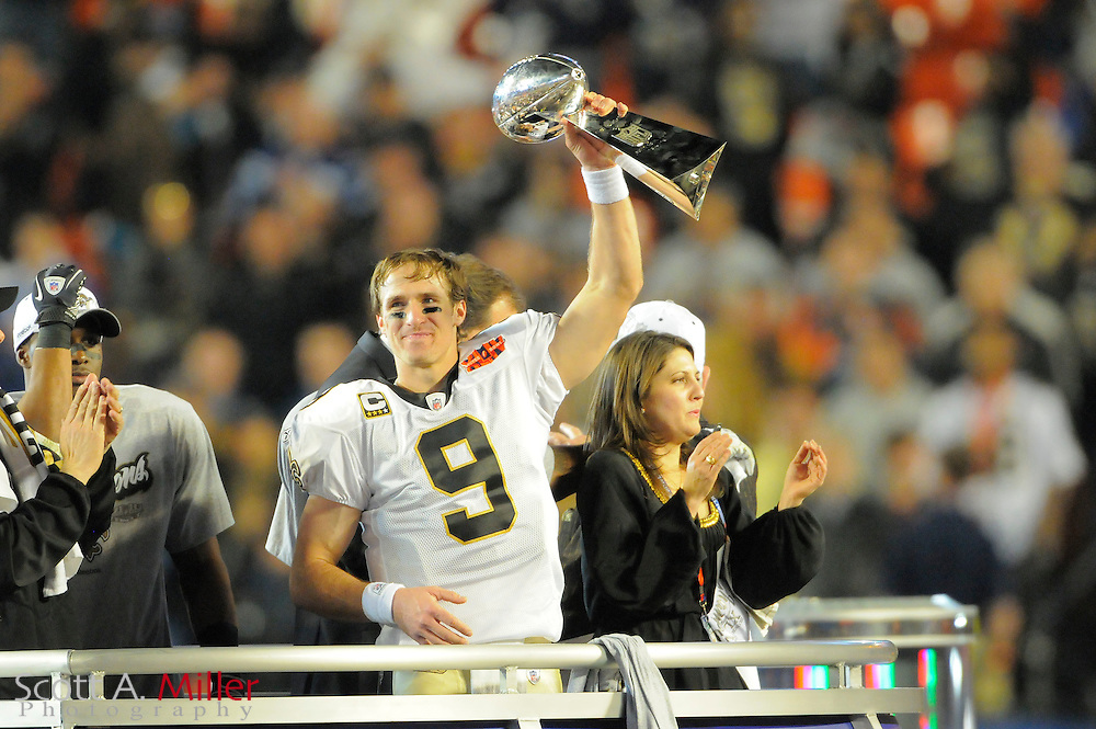 Miami, FL, USA; New Orleans Saints quarterback Drew Brees celebrates with the Vince Lombardi Trophy after his team beat the Indianapolis Colts 31-17 in Super Bowl XLIV at Sun Life Stadium on Feb 7, 2010...©2010 Scott A. Miller