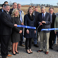 Several officials gathered for a ribbon cutting ceremony last Friday for the Amory Port North Site's new natural gas line. Service is expected to be available in March.