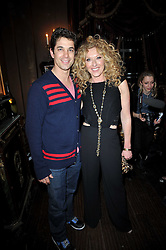 ADAM GARCIA and KELLY HOPPEN at a party to celebrate the publication of her new book - Kelly Hoppen: Ideas, held at Beach Blanket Babylon, 45 Ledbury Road, London W11 on 4th April 2011.