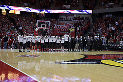 20 March 2017:  UCF Knights players, coaches and staff line up for the national anthem during a College NIT (National Invitational Tournament) 2nd round mens basketball game between the UCF (University of Central Florida) Knights and Illinois State Redbirds in  Redbird Arena, Normal IL