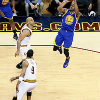 10 June 2016: Golden State Warriors forward Andre Iguodala (9) takes a jump shot over Cleveland Cavaliers forward Channing Frye (9) and Cleveland Cavaliers forward Richard Jefferson (24) during the Golden State Warriors 108-97 victory over the Cleveland Cavaliers, during Game Four of the 2016 NBA Finals at the Quicken Loans Arena, Cleveland, Ohio, USA.