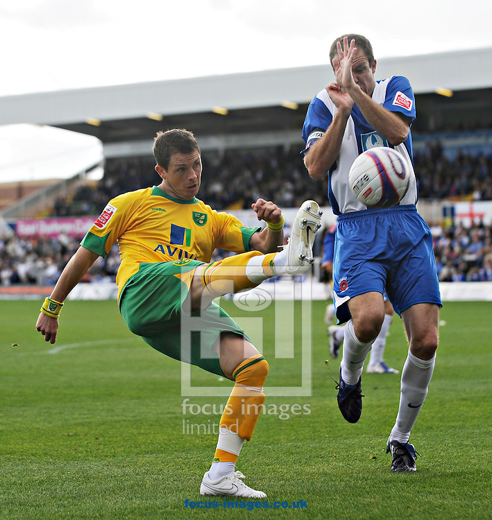 Hartlepool - Saturday August 29th, 2009: Sam Collins (R) of Hartlepool and Jamie Cureton of Norwich City during the Coca Cola League One match at Victoria Park, Hartlepool. (Pic by Jed Wee/Focus Images)..