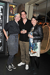 Left to right, THOMASINA MIERS, VALENTINE & CHARLOTTE WARNER at a Mexican Feast cooked by Thomasina Miers in aid of the charity Too Many Women held at Wahaca Soho, 80 Wardour Street, London on 9th November 2011.