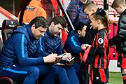 Tottenham Hotspur manager Mauricio Pochettino sat in the dugout signing autographs for the youngsters before the Premier League match between Bournemouth and Tottenham Hotspur at the Vitality Stadium, Bournemouth, England on 11 March 2018. Picture by Graham Hunt.