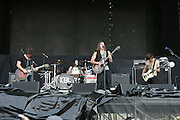 Kings of Leon featuring Caleb Followill (rhythm guitar/lead vocals), Jared Followill (bass guitar), Nathan Followill (drums/percussion/backup vocals), and Matthew Followill (lead guitar) performs during the second day of the 2007 Bonnaroo Music & Arts Festival on June 15, 2007 in Manchester, Tennessee. The four-day music festival features a variety of musical acts, arts and comedians..Photo by Bryan Rinnert.