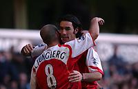 Fotball<br /> England 2004/2005<br /> Foto: SBI/Digitalsport<br /> NORWAY ONLY<br /> <br /> Tottenham Hotspur v Arsenal<br /> 13/11/2004<br /> <br /> Arsenal's fifth goal scorer Robert Pires celebrates with fellow goal scorer Fredrik Ljungberg