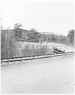 "View of steel automobile bridge over Dolores River south of town.  RGS mainline is in foreground.<br /> RGS    <br /> In book ""Rio Grande Southern II, The: An Ultimate Pictorial Study"" page 315"
