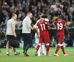 May 26, 2018 - Kiev, Ukraine - Liverpool's Egyptian forward Mohamed Salah is comforted by Real Madrid's Sergio Ramos as he leaves the pitch after injury during the UEFA Champions League final football match between Liverpool and Real Madrid at the Olympic Stadium in Kiev, Ukraine on May 26, 2018. (Credit Image: © Raddad Jebarah/NurPhoto via ZUMA Press)