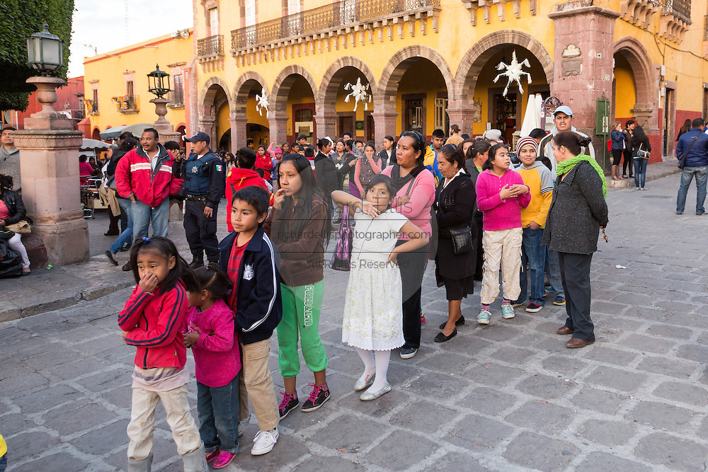 Children wait in line to get gifts from the Three Kings during El Dia de Reyes in the historic Jardin January 6, 2016 in San Miguel de Allende, Mexico. The traditional festival marks the culmination of the twelve days of Christmas and commemorates the three wise men who traveled from afar, bearing gifts for the infant baby Jesus.